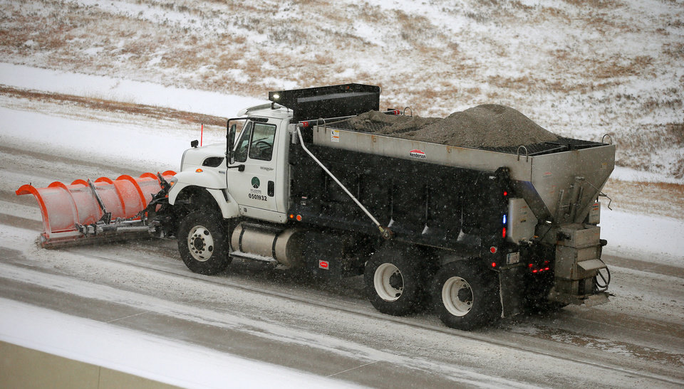 Photo - A sand truck clears a westbound lane of the Kilpatrick Turnpike in Oklahoma City during a winter storm, Thursday, December, 5, 2013. Photo by Bryan Terry, The Oklahoman