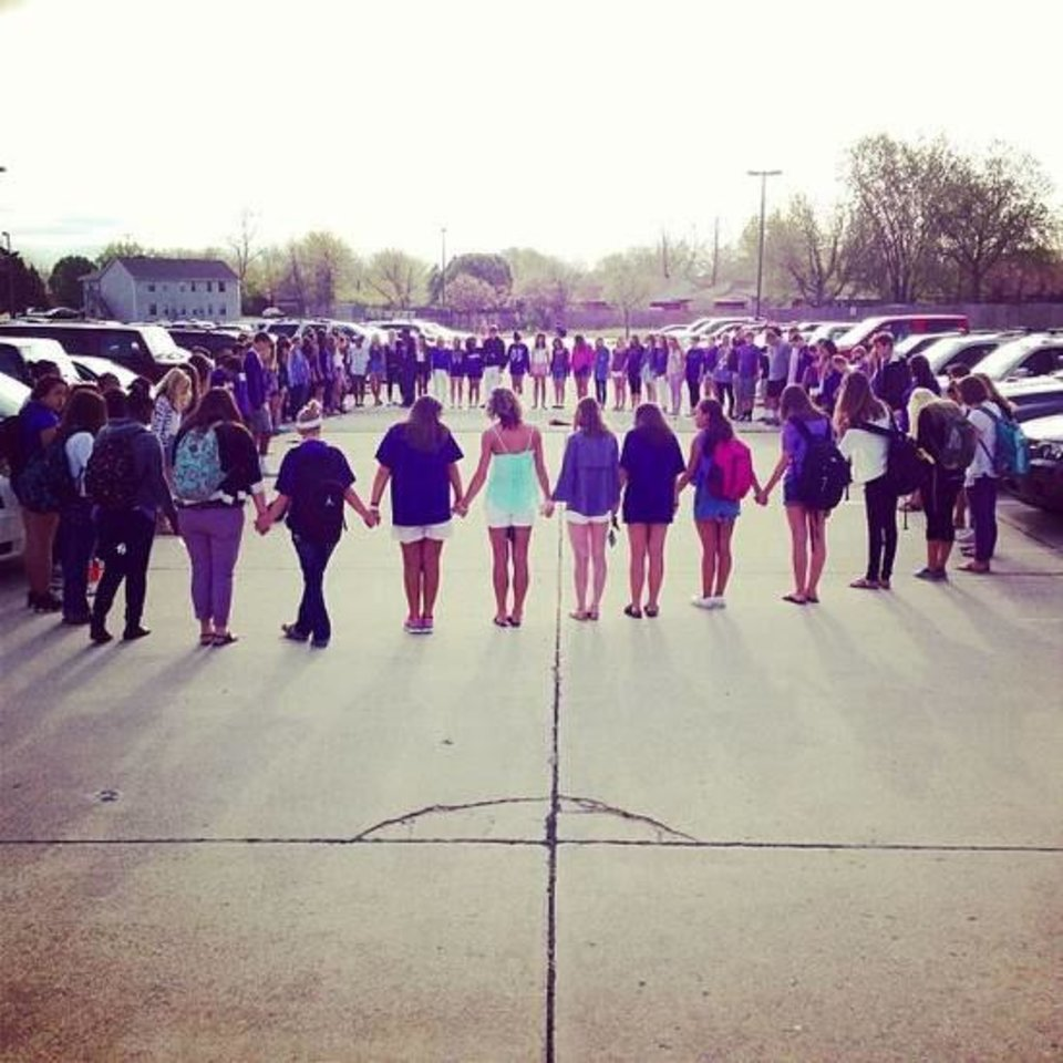 This reader-submitted photo shows a prayer circle at Norman North High School on Monday morning for Audra Plusquellec, a senior. Students prayed throughout the day for Plusquellec, who is in the Intensive Care Unit at Integris Medical Center battling a life-threatening illness. Students also wore purple on Monday to show support for the critically ill teenager. PHOTO PROVIDED <strong></strong>