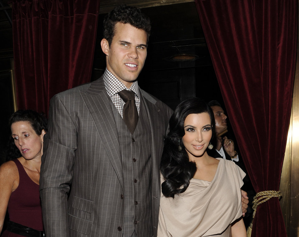 "FILE - This Aug. 31, 2011 file photo shows Kim Kardashian and Kris Humphries attending a party thrown in their honor at Capitale in New York. Kardashian's attorney Laura Wasser told a judge on Wednesday Nov. 28, 2012 that the reality starlet is ""handcuffed"" to her estranged husband, Humphries, and unable to move on with her life because the NBA player continues to seek an annulment but is not ready for trial. (AP Photo/Evan Agostini, file)"