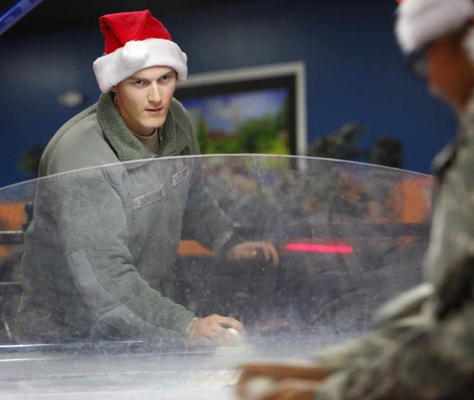 New recruit Pvt Keith Soreghen plays air hockey at Gatti Town during Soldiers Day Out, Friday, December 21, 2012. Edmond/North OKC Blue Star Mothers will be taking the soldiers who can't go home for Christmas around the metro for a day of fun. Photo By David McDaniel/The Oklahoman