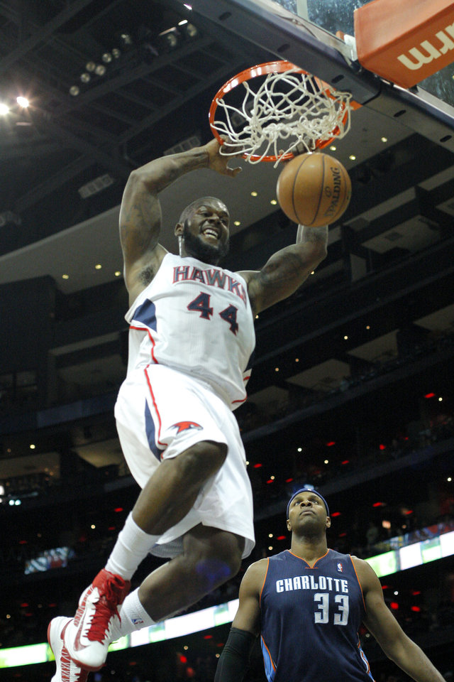 Atlanta Hawks power forward Ivan Johnson (44) dunks over Charlotte Bobcats center Brendan Haywood (33)  during the second half of an NBA basketball game on Thursday, Dec. 13, 2012, in Atlanta. The Hawks won 113-90. (AP Photo/Todd Kirkland)