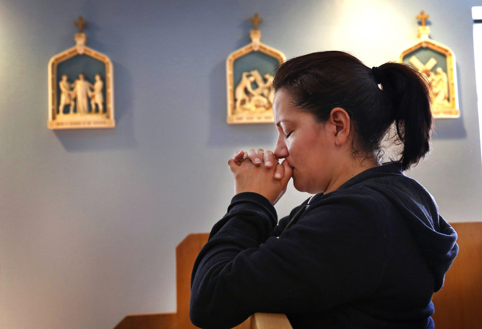 Photo - Marilou Romo prays in Holy Innocents Chapel. The Catholic Archdiocese of Oklahoma City opened Holy Innocents Chapel next door to an abortion clinic a year ago. It is the Holy Innocents Chapel and it will be on the front lines of the annual anti-abortion initiative,