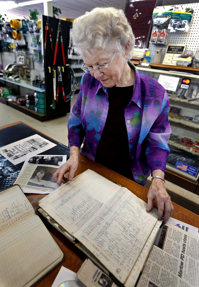 Photo - Nancy Crow shows a journal with lawn mower customers dating back to 1966 in her OTASCO store on Tuesday, July 8, 2014 in Marlow, Okla.  Photo by Steve Sisney, The Oklahoman