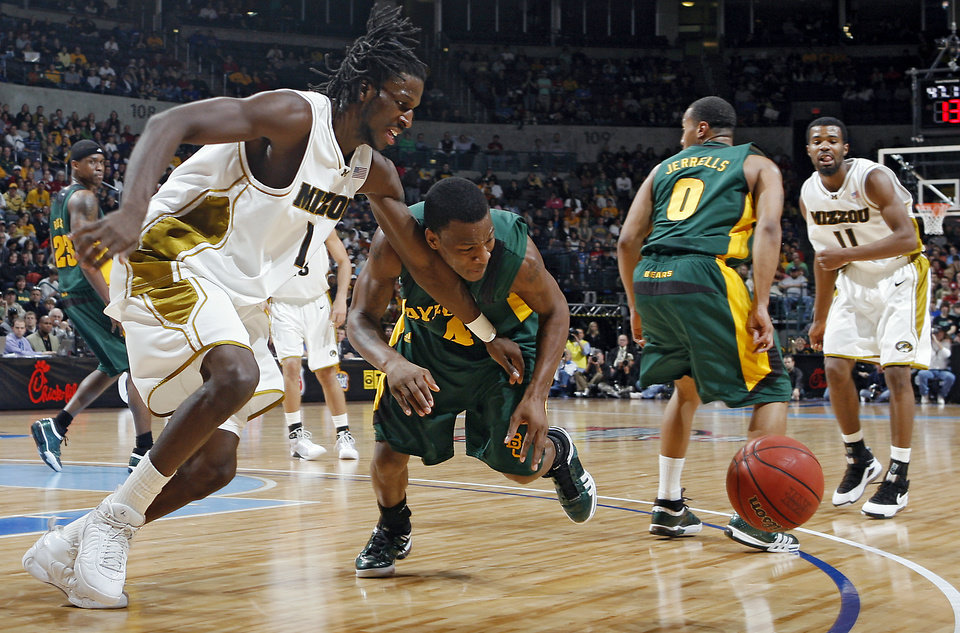 Missouri\'s DeMarre Corroll (1) and Baylor\'s Quincy Acy (4) go after a loose ball in the Championship game of the Big 12 Men\'s Basketball Championships between Baylor University and The University of Missouri at the Ford Center on Saturday, March 14, 2009, in Oklahoma City, Okla. PHOTO BY CHRIS LANDSBERGER, THE OKLAHOMAN