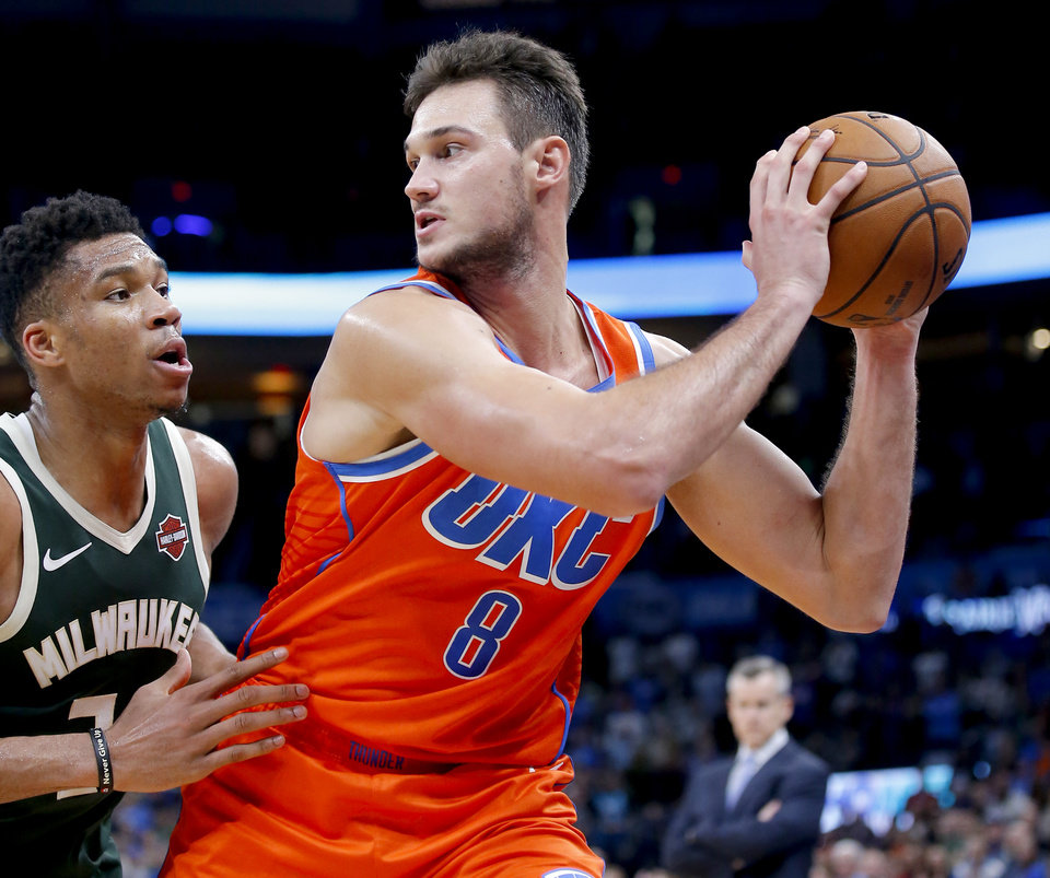 Photo - Oklahoma City's Danilo Gallinari (8) looks to get around Milwaukee's Giannis Antetokounmpo (34) during the NBA game between the Oklahoma City Thunder and the Milwaukee Bucks at Chesapeake Energy Arena,   Sunday, Nov. 10, 2019.  [Sarah Phipps/The Oklahoman]