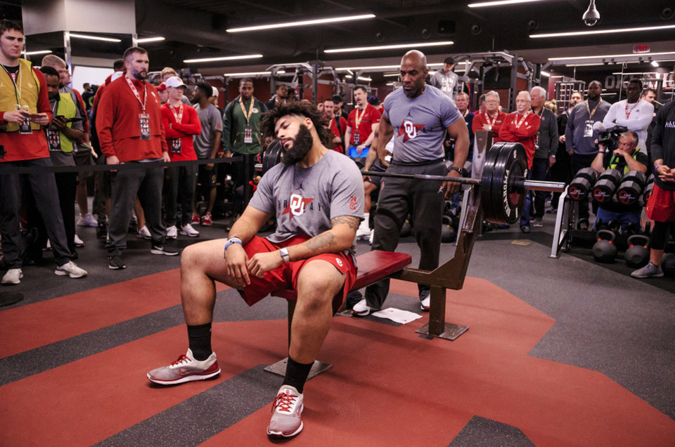 Photo - Cody Ford prepares to do the bench press as he works out for NFL scouts during the University of Oklahoma football pro day at the University of Oklahoma in Norman, Okla. on Wednesday, March 13, 2019.   Photo by Chris Landsberger, The Oklahoman