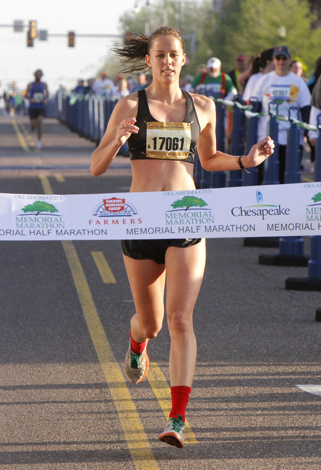 Photo - Norman resident Lauren Watson wins the women's half-marathon of the Oklahoma City Memorial Marathon in Oklahoma City, Sunday, April 28, 2013,  By Paul Hellstern, The Oklahoman