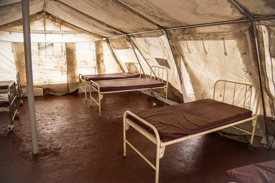 Photo - Beds for patients are seen inside a tent at the recently opened but unstaffed Ebola treatment center in the village of Lakka on the outskirts of Freetown, Sierra Leone, Thursday,  Aug. 7, 2014. While the Ebola virus outbreak has now reached four countries, Liberia and Sierra Leone account for more than 60 percent of the deaths, according to the World Health Organization. The outbreak that emerged in March has claimed at least 932 lives. (AP Photo/Michael Duff)