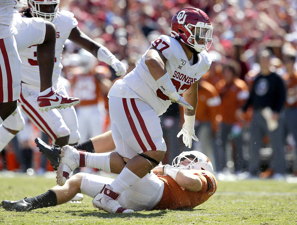 Photo - Oklahoma's Marquise Overton (97) celebrates his sack on Texas quarterback Sam Ehlinger (11) in the fourth quarter during the Red River Showdown college football game between the University of Oklahoma Sooners (OU) and the Texas Longhorns (UT) at Cotton Bowl Stadium in Dallas, Saturday, Oct. 12, 2019. OU won 34-27. [Sarah Phipps/The Oklahoman]