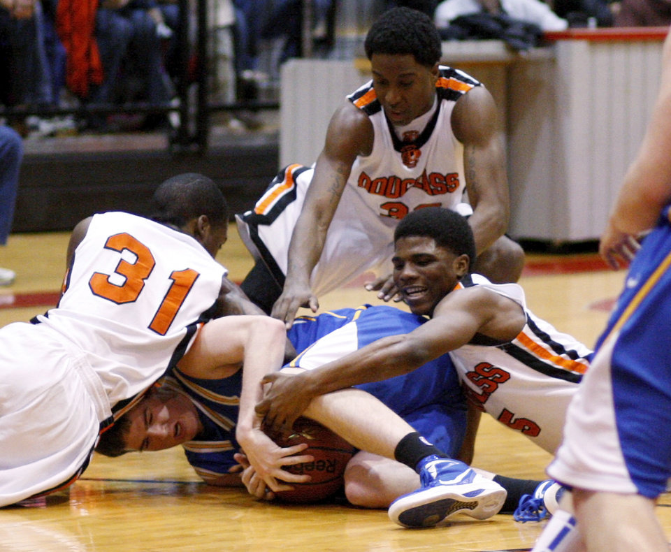 Stephen Clark, at right, Najee Cox, and Dydrell Post of Douglass, left, fight for the ball with Piedmont's Connor McFall during a Class 4A boys basketball state tournament game in Midwest CIty, Okla., Thursday, March 8, 2012. Photo by Bryan Terry, The Oklahoman