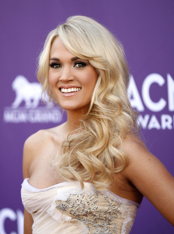 ACM AWARDS: Carrie Underwood arrives at the 47th Annual Academy of Country Music Awards on Sunday, April 1, 2012 in Las Vegas. (AP Photo/Isaac Brekken) ORG XMIT: NVPM218