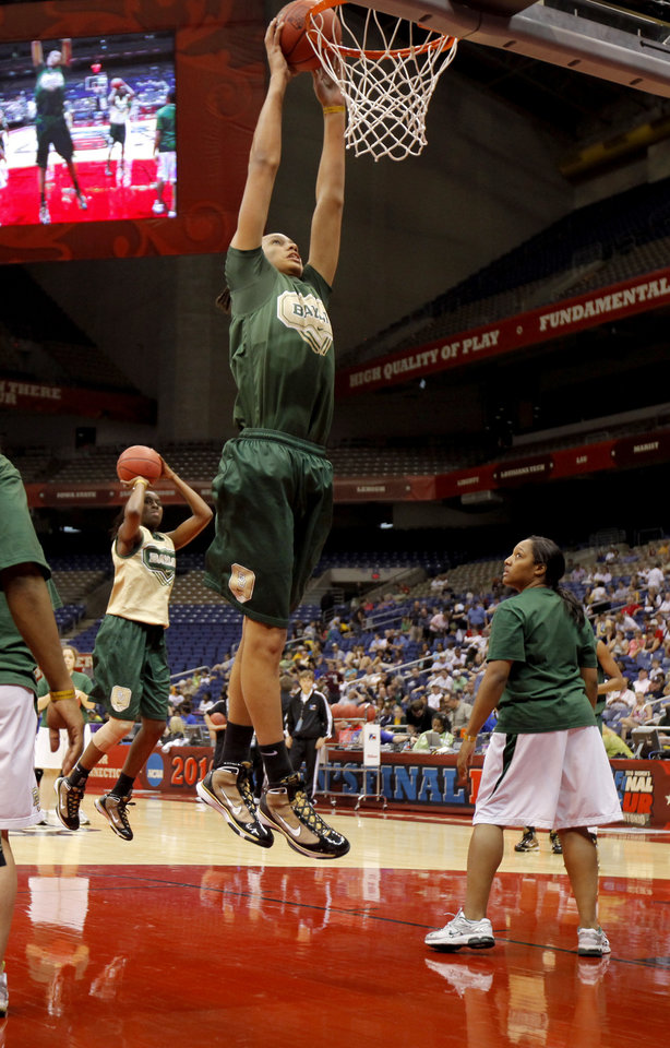 Photo - Baylor's Brittney Griner dunks the ball during practice before the Final Four of the NCAA women's  basketball tournament  in San Antonio, Texas., on Saturday, April 3, 2010.  The University of Oklahoma will play Stanford on Sunday, April 4, 2010.