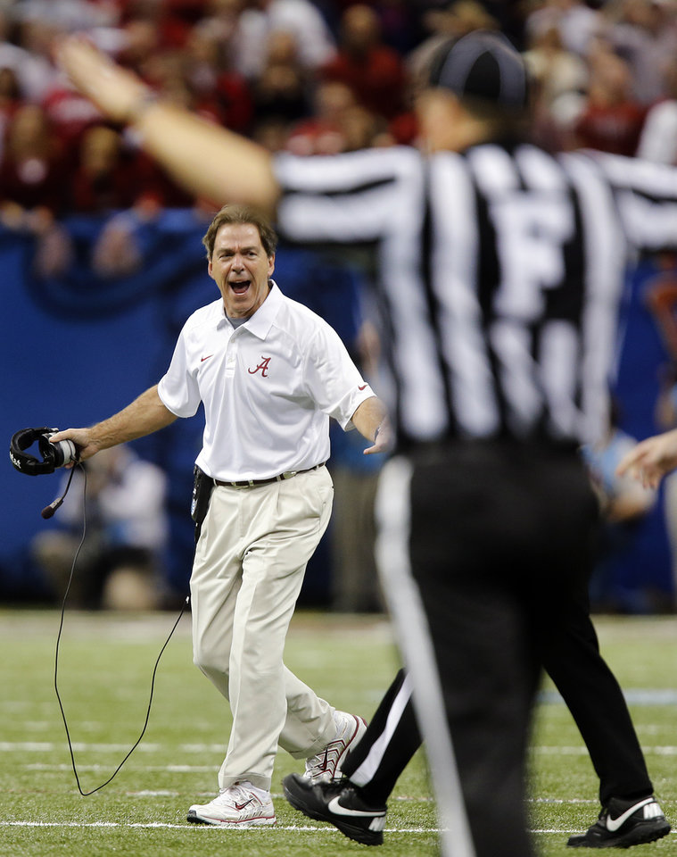Photo - Alabama coach Nick Saban yells at the officials about a pass interference call during the NCAA football BCS Sugar Bowl game between the University of Oklahoma Sooners (OU) and the University of Alabama Crimson Tide (UA) at the Superdome in New Orleans, La., Thursday, Jan. 2, 2014.  .Photo by Chris Landsberger, The Oklahoman