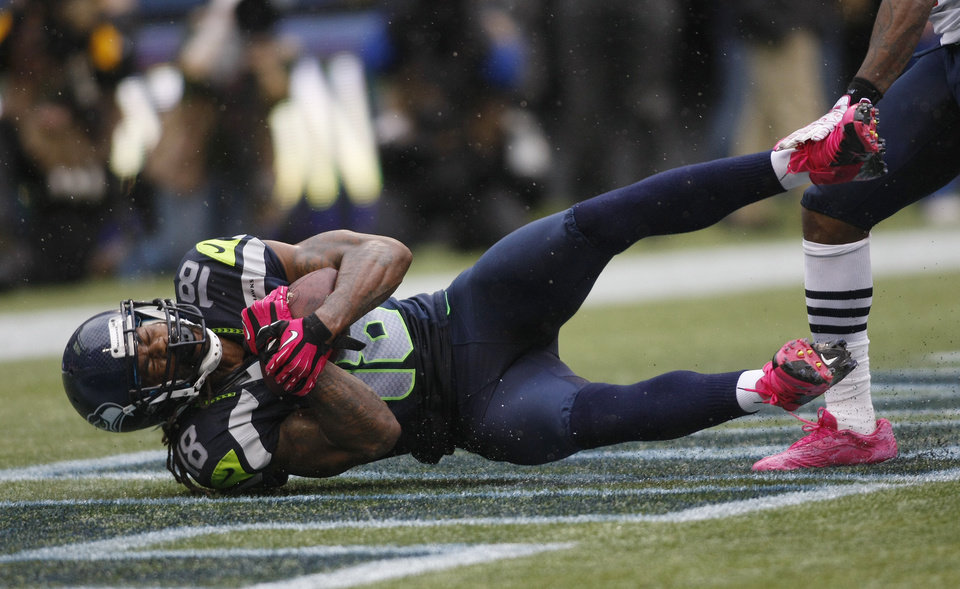 Photo -   Seattle Seahawks' Sidney Rice comes down with a game-winning touchdown reception in the second half of an NFL football game against the New England Patriots, Sunday, Oct. 14, 2012, in Seattle. The Seahawks beat the Patriots, 24-23. (AP Photo/John Froschauer)
