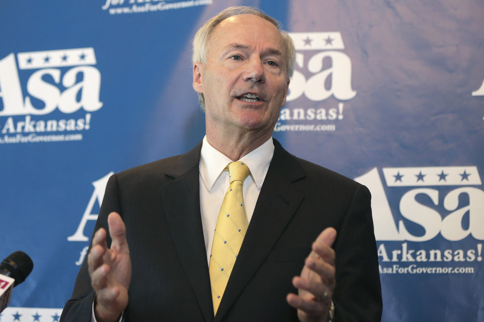 Photo - Republican candidate for Arkansas governor Asa Hutchinson speaks to reporters in Little Rock, Ark., Monday, Aug. 4, 2014. Hutchinson is vowing to join a lawsuit that 12 other states have joinedchallenging the federal's government's proposed rules for power-plant pollution. (AP Photo/Danny Johnston)