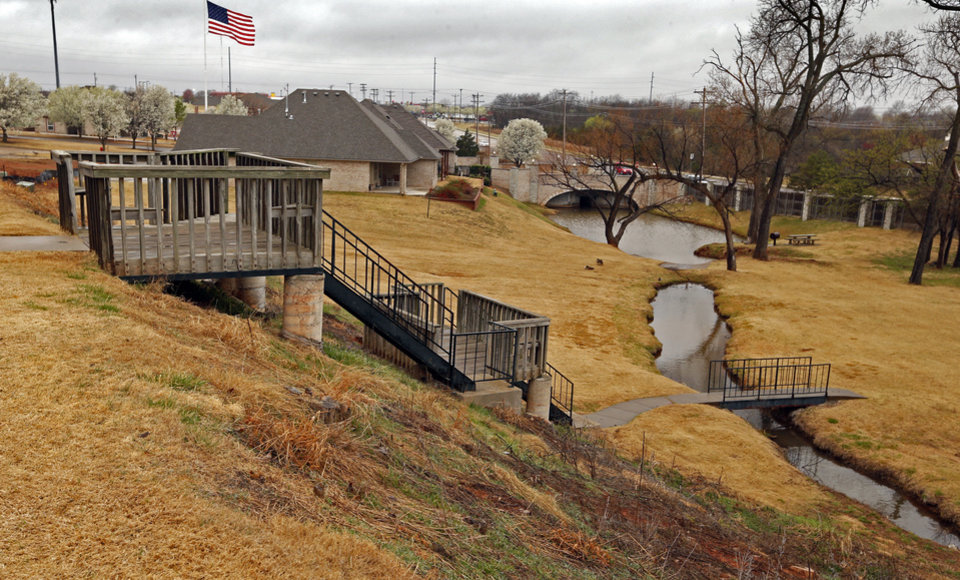 Photo -  An overlook at the dam in the Summit Lakes Addition provides a view of housing areas below the dam and Alameda Street in the distance. [PHOTO BY STEVE SISNEY, THE OKLAHOMAN]