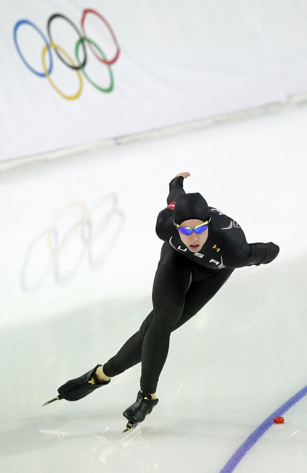 Photo - Patrick Meek of the U.S. skates competes in the men's 5,000-meter speedskating race at the Adler Arena Skating Center during the 2014 Winter Olympics, Saturday, Feb. 8, 2014, in Sochi, Russia. (AP Photo/Pavel Golovkin)