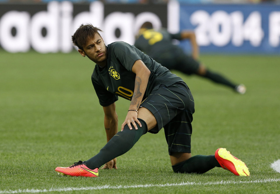 Photo - Brazil's Neymar practices during an official training session the day before the group A World Cup soccer match between Brazil and Croatia in the Itaquerao Stadium in Sao Paulo, Brazil, Wednesday, June 11, 2014. (AP Photo/Kirsty Wigglesworth)