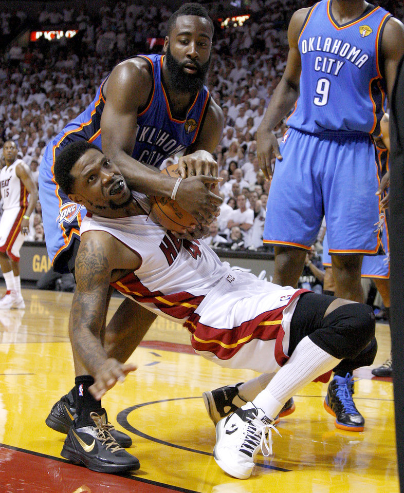 Photo - Oklahoma City's James Harden (13) fights for the ball with Miami's Udonis Haslem (40) during Game 4 of the NBA Finals between the Oklahoma City Thunder and the Miami Heat at American Airlines Arena, Tuesday, June 19, 2012. Oklahoma City lost 104-98.  Photo by Bryan Terry, The Oklahoman