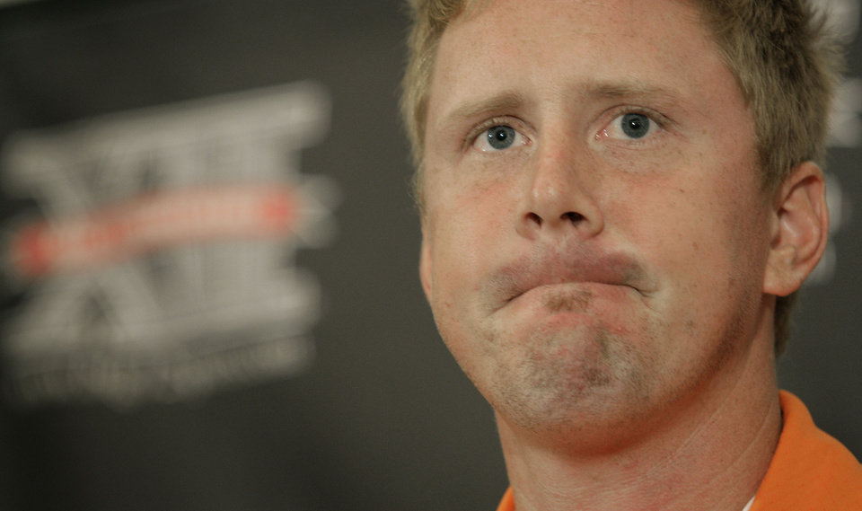 Photo - OSU quarterback Brandon Weeden answers questions from the media during Big 12 Media Days. AP PHOTO
