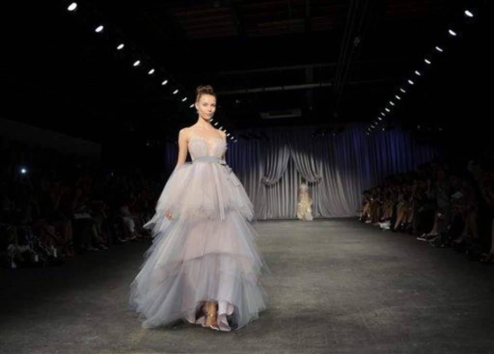 Photo - The Christian Siriano Spring 2013 collection is modeled during Fashion Week in New York, Saturday Sept 8, 2012. (AP Photo/Stephen Chernin)