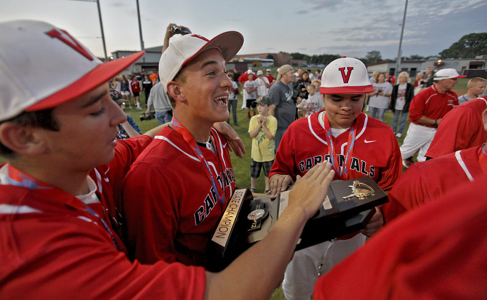 Verdigris' Ryan Skalnik holds the state championship trophy as the team celebrates after the 6-5 win over Metro Christian during the 3A State Championship baseball game at Edmond Memorial High School on Saturday,  May 12, 2012, in Edmond, Oklahoma. Photo by Chris Landsberger, The Oklahoman