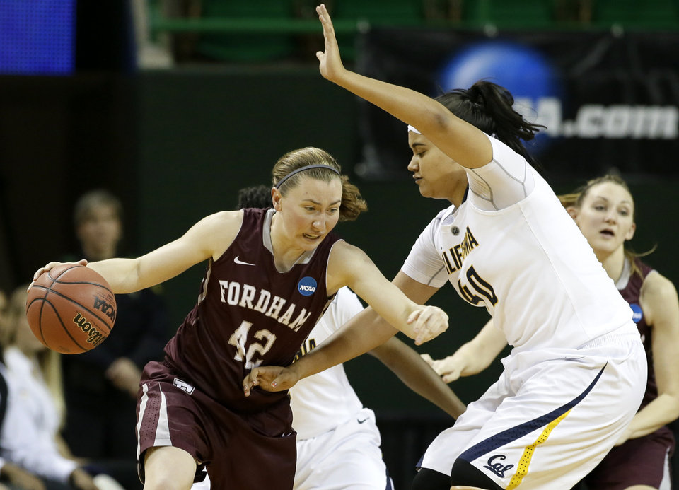 Photo - Fordham's Abigail Corning (42) attempts to get around the defense of California's Justine Hartman (40) in the first half of a first-round game in the NCAA women's college basketball tournament, Saturday, March 22, 2014, in Waco, Texas. (AP Photo/Tony Gutierrez)