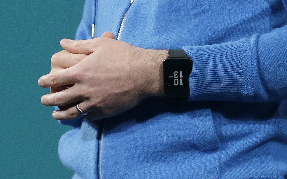 Photo - David Singleton, Android director of engineering, wears an Android Wear watch on his wrist while speaking at the Google I/O 2014 keynote presentation in San Francisco, Wednesday, June 25, 2014. As the Internet giant's Android operating system stretches into cars, homes and smartwatches, this year's annual confab will expand on its usual focus on smartphones and tablets. (AP Photo/Jeff Chiu)
