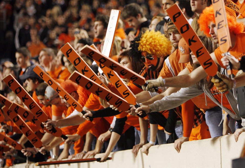 Photo - OSU fans make noise during the college football game between Oklahoma State University (OSU) and the University of Colorado (CU) at Boone Pickens Stadium in Stillwater, Okla., Thursday, Nov. 19, 2009. Photo by Nate Billings, The Oklahoman