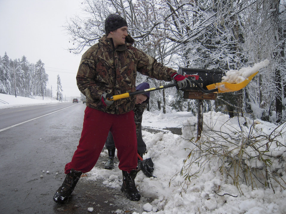Photo -   Keith and Jessica Brown clear snow from around their mailbox near McHenry, Md., on Thursday, Nov. 1, 2012. About 15,000, or nearly 70 percent of Garrett Countyís homes and businesses, were in their third day without electricity due to outages caused by snow from Superstorm Sandy. (AP Photo/David Dishneau)