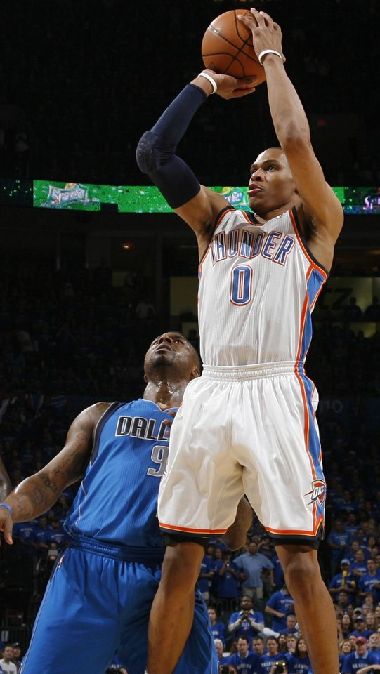 Oklahoma City's Russell Westbrook (0) takes a shot in front of DeShawn Stevenson (92) in the first half during game 4 of the Western Conference Finals in the NBA basketball playoffs between the Dallas Mavericks and the Oklahoma City Thunder at the Oklahoma City Arena in downtown Oklahoma City, Monday, May 23, 2011. Photo by Nate Billings, The Oklahoman