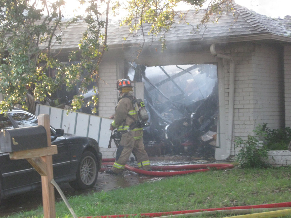 Photo - Oklahoma City firefighters battle a blaze at 6205 Latham Court Thursday evening.