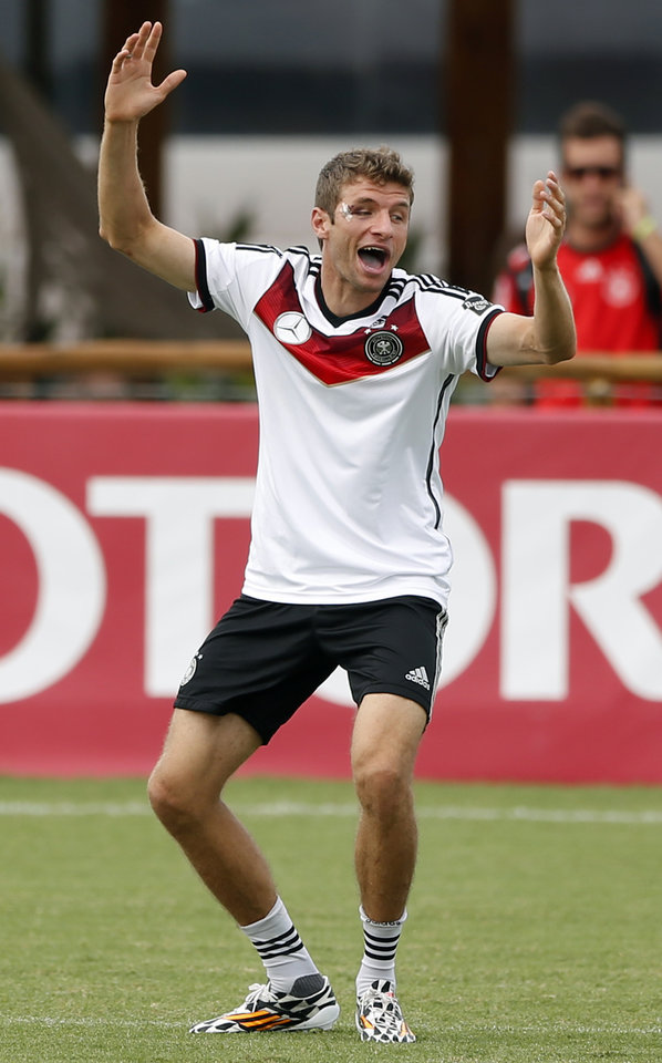 Photo - German national soccer player Thomas Mueller laughs during a training session in Santo Andre near Porto Seguro, Brazil, Monday, June 23, 2014. Germany play in group G of the 2014 soccer World Cup. (AP Photo/Matthias Schrader)