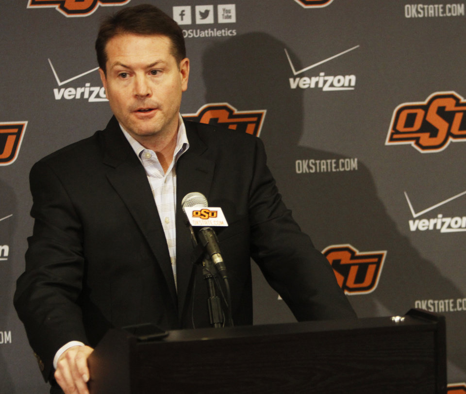 Photo - Oklahoma State basketball coach Travis Ford addresses media members at a press conference held in Gallagher Iba Arena on Sunday, Feb. 9, 2014, in regards to star player Marcus Smart shoving a fan in an altercation during a game Saturday, Feb. 8, 2014. Smart was given a three game suspension by the Big 12 conference and Oklahoma State. Photo by KT King/The Oklahoman