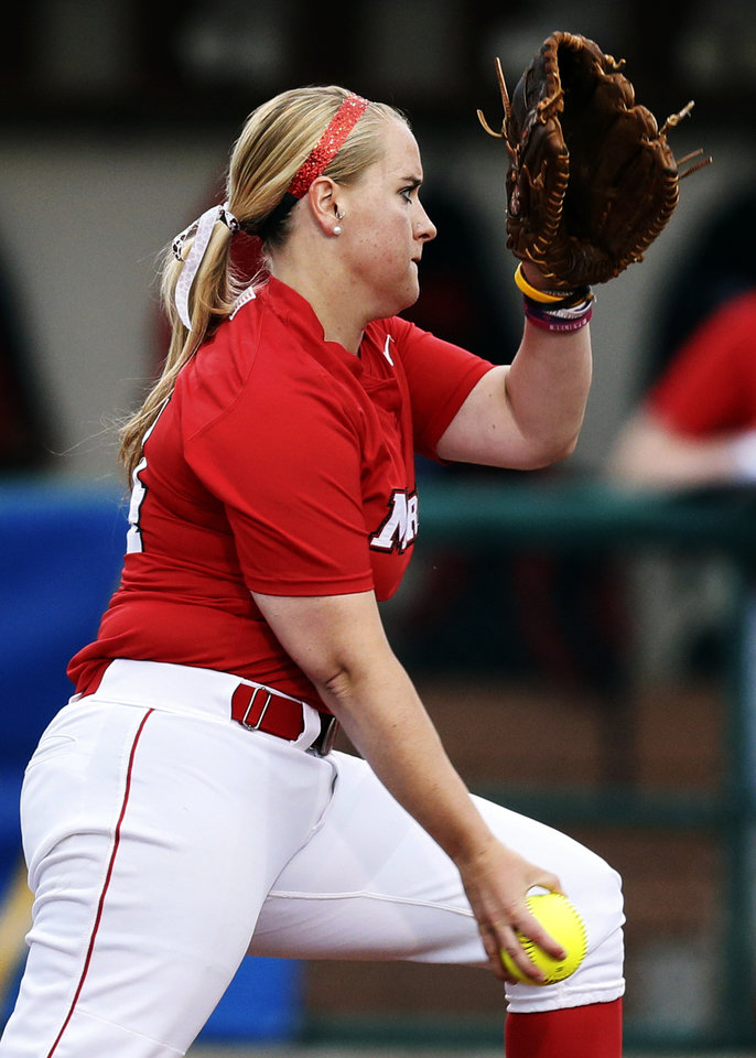 Emily Osterhaus (14) pitches for Marist during an NCAA softball game between OU and Marist in the Oklahoma Regional in Norman, Okla., Friday, May 17, 2013. Photo by Nate Billings, The Oklahoman