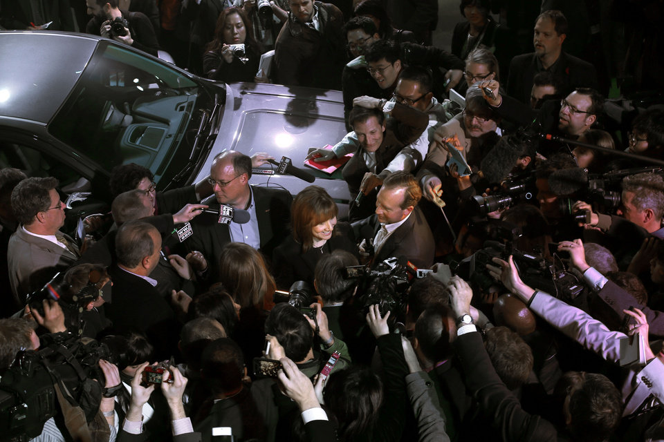 Photo - Incoming General Motors CEO Mary Barra is surrounded by media at the debut of the 2015 GMC Canyon during media previews for the North American International Auto Show, Sunday, Jan. 12, 2014, in Detroit. (AP Photo/Paul Sancya)