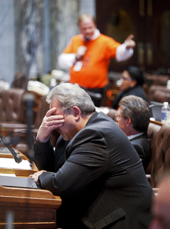 FILE - In this Feb. 23, 2011 file photo, Wisconsin Rep. Mark Honadel, R-South Milwaukee, rubs his eyes during the 23rd hour of debate on the governor's bill to eliminate collective bargaining rights for many state workers in the state Assembly at the Capitol in Madison, Wis. The incoming speaker of the Assembly has some ideas for ending all-night sessions, an all-too-familiar method of doing the state's business. He planned to make his ideas public Tuesday, Jan. 8, 2012, before a vote Thursday that could itself go all night. (AP Photo/Andy Manis, File)
