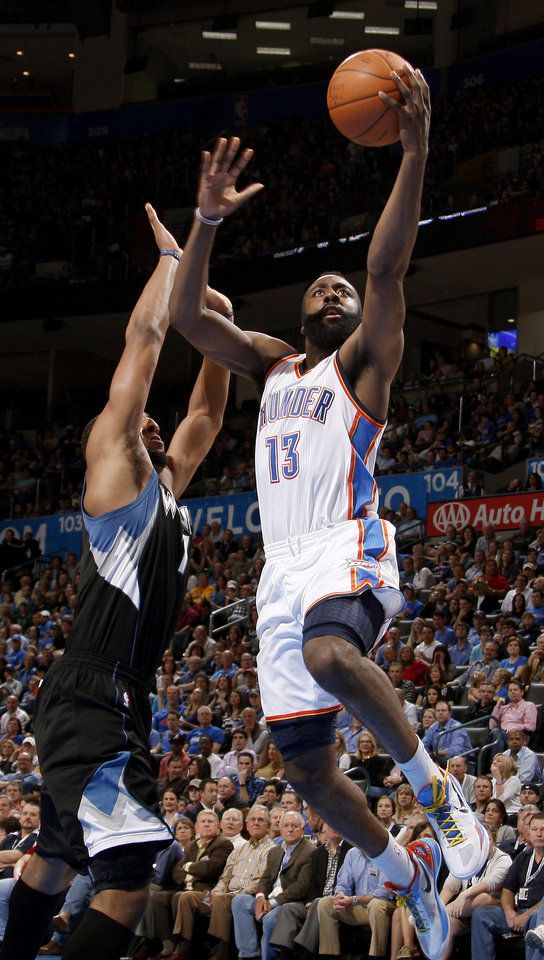 Oklahoma City's James Harden (13) got past Minnesota's Derrick Williams (7) during the NBA basketball game between the Oklahoma City Thunder and the Minnesota Timberwolves at Chesapeake Energy Arena in Oklahoma City, Friday, March 23, 2012. Photo by Bryan Terry, The Oklahoman
