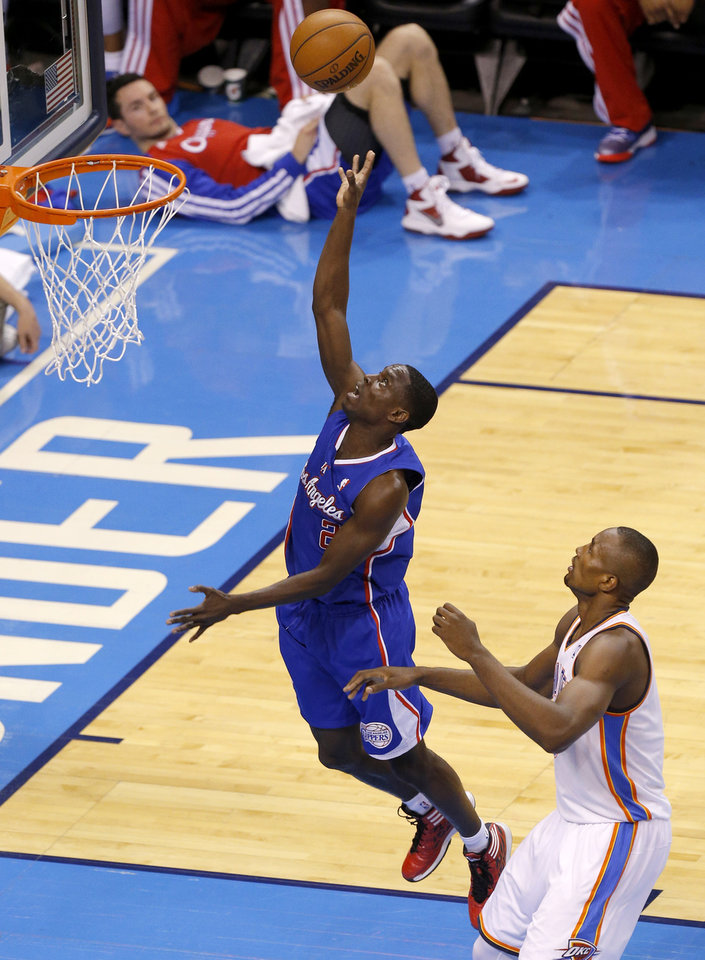 Photo - Los Angeles' Darren Collison (2) got to the basket past Oklahoma City's Serge Ibaka (9) during Game 1 of the Western Conference semifinals in the NBA playoffs between the Oklahoma City Thunder and the Los Angeles Clippers at Chesapeake Energy Arena in Oklahoma City, Monday, May 5, 2014. Photo by Bryan Terry, The Oklahoman