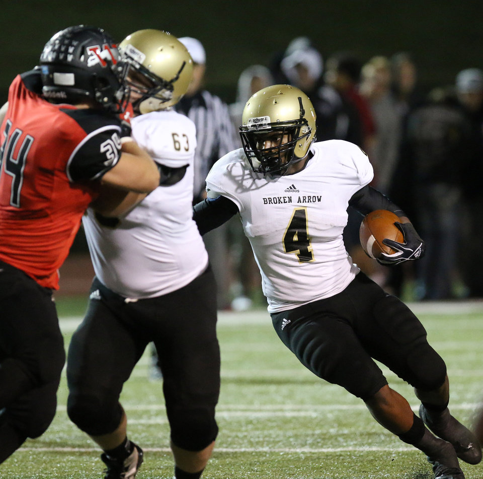 Photo - BA #4 Zach Sallee looks for room to run during the high school football game between Broken Arrow and Westmoore at Moore stadium Friday , November 8, 2013. Photo by Doug Hoke, The Oklahoman