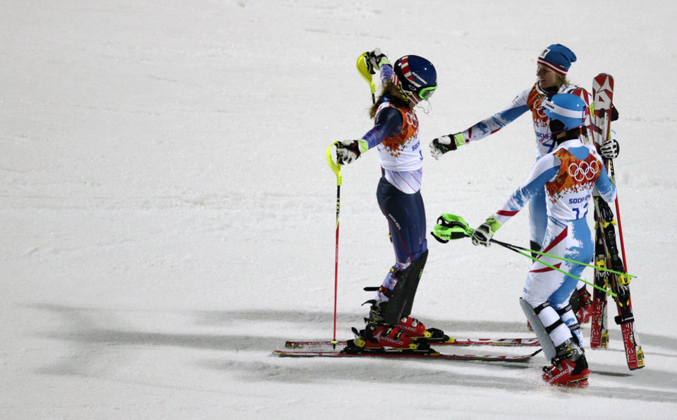 Photo - Women's slalom gold medalist, United States' Mikaela Shiffrin, left, is congratulated by Austria's Marlies Schild (silver), and Kathrin Zettel (bronze) at the Sochi 2014 Winter Olympics, Friday, Feb. 21, 2014, in Krasnaya Polyana, Russia.(AP Photo/Charles Krupa)
