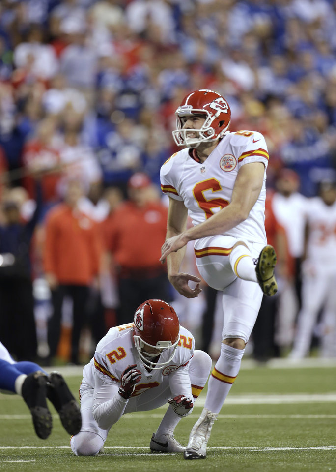 Photo - Kansas City Chiefs kicker Ryan Succop (6) makes a 19-yard field goal against the Indianapolis Colts during the first half of an NFL wild-card playoff football game Saturday, Jan. 4, 2014, in Indianapolis. (AP Photo/AJ Mast)