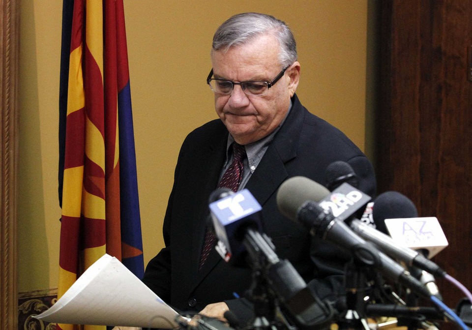 Photo -   Maricopa County Sheriff Joe Arpaio, arrives to answer questions regarding the Department of Justice announcing a federal civil lawsuit against Sheriff Arpaio and his department, prior to a news conference Thursday, May 10, 2012, in Phoenix. According to the Department of Justice, after months of negotiations failed to yield an agreement to settle allegations that the sheriff's department racially profiled Latinos in his trademark immigration patrols, the lawsuit was filed.(AP Photo/Ross D. Franklin)
