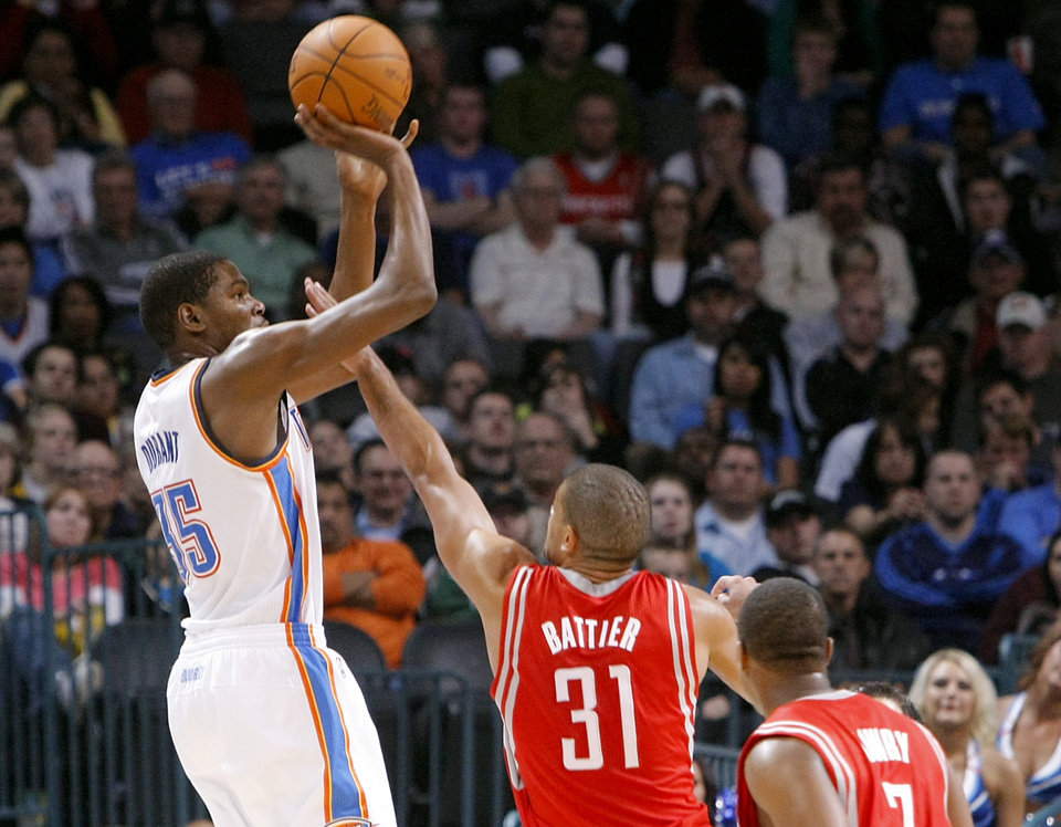 Photo - Oklahoma City's Kevin Durant is pressured by Houston's Shane Battier during their NBA basketball game at the OKC Arena in downtown Oklahoma City on Wednesday, Nov. 17, 2010. Photo by John Clanton, The Oklahoman