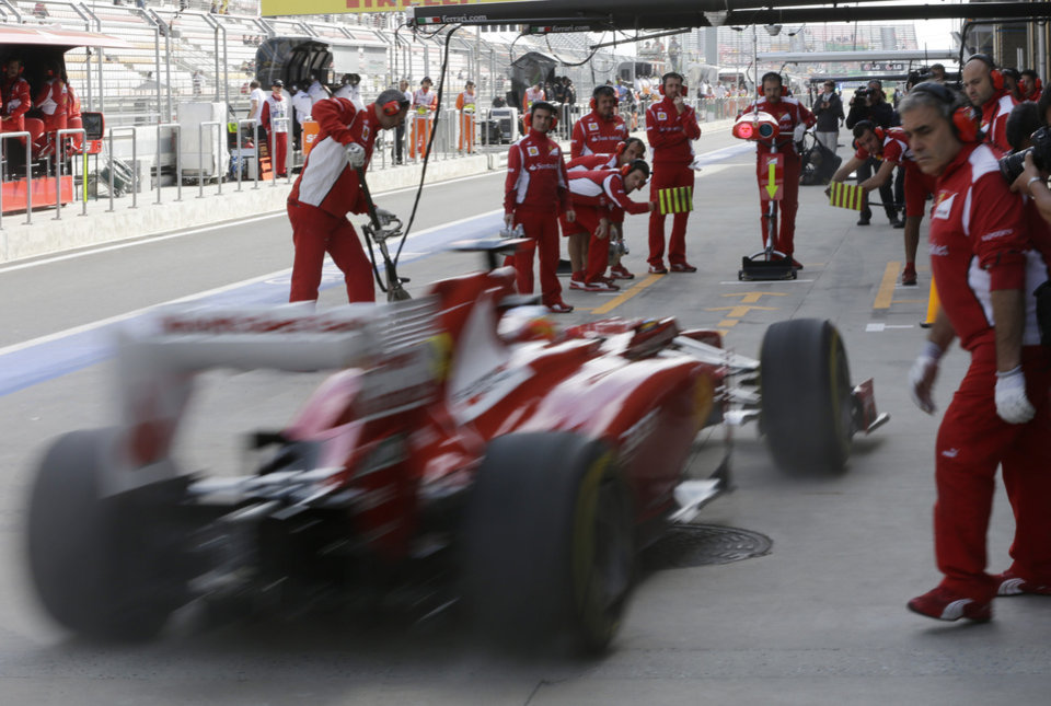Photo -   Ferrari driver Fernando Alonso of Spain steers his car into pit lane during the first practice session for the Korean Formula One Grand Prix at the Korean International Circuit in Yeongam, South Korea, Friday, Oct. 12, 2012. (AP Photo/Mark Baker)