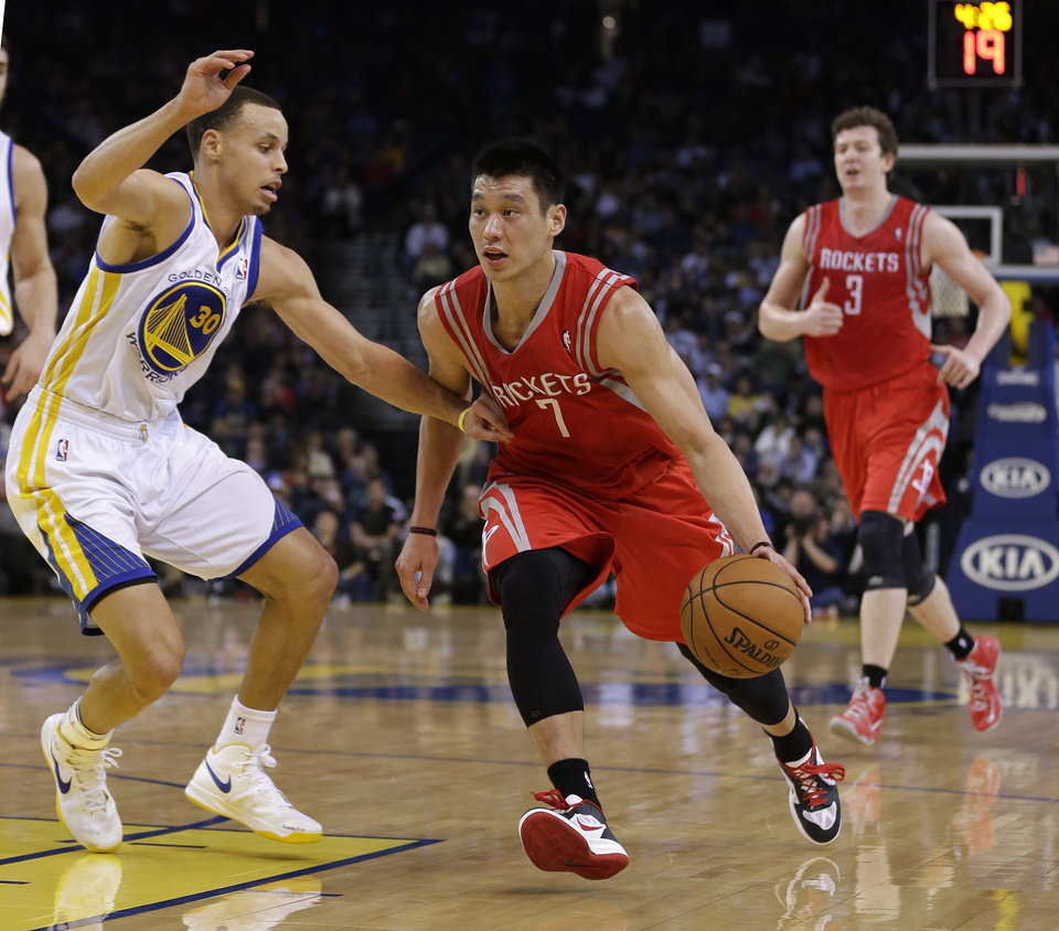 Houston Rockets' Jeremy Lin (7) tries to dribble past Golden State Warriors' Stephen Curry (30) during the first half of an NBA basketball game in Oakland, Calif., Tuesday, Feb. 12, 2013. (AP Photo/Marcio Jose Sanchez)