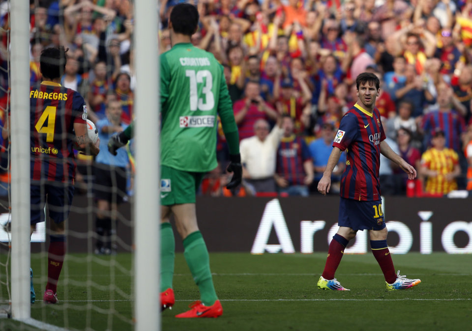 Photo - Barcelona's Lionel Messi from Argentina, right, looks on during a Spanish La Liga soccer match between FC Barcelona and Atletico Madrid at the Camp Nou stadium in Barcelona, Spain, Saturday, May 17, 2014. (AP Photo/Emilio Morenatti)