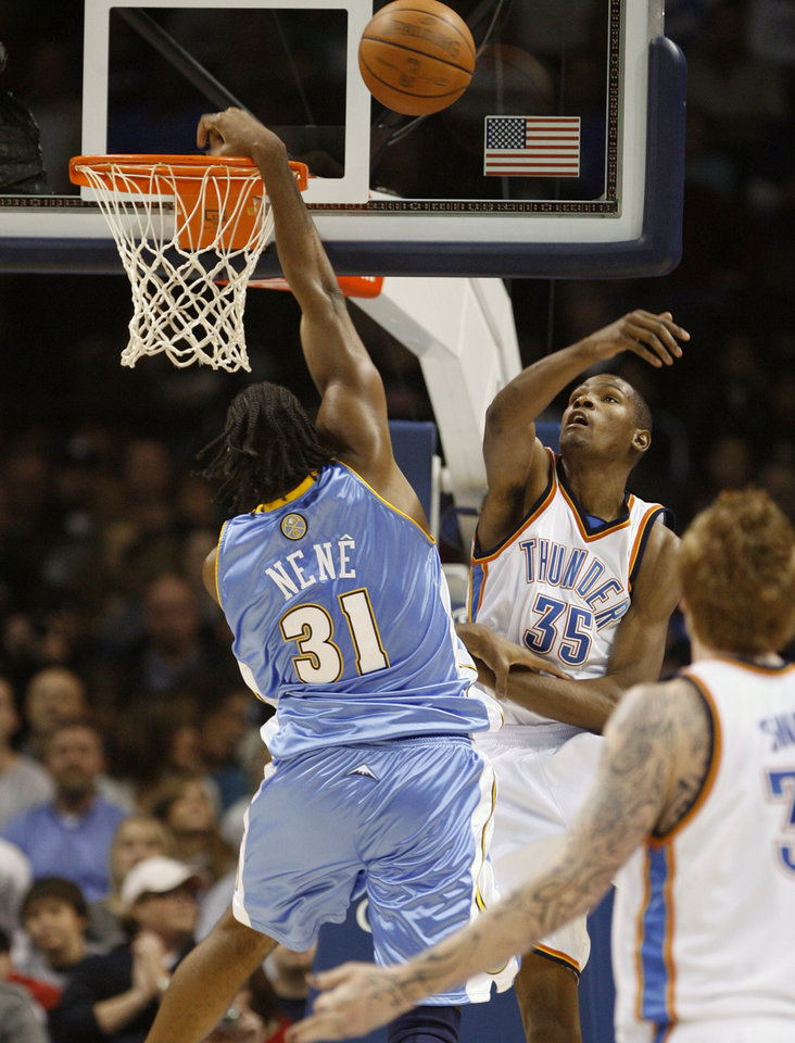 Photo - NBA BASKETBALL: Kevin Durant blocks a shot by Nene in the first half as the Oklahoma City Thunder play the Denver Nuggets at the Ford Center in Oklahoma City, Okla. on Friday, January 2, 2009.   Photo by Steve Sisney/The Oklahoman ORG XMIT: kod