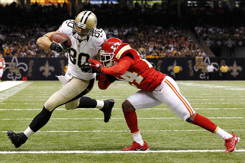 Photo -   New Orleans Saints tight end Jimmy Graham (80) crosses the goal line for a touchdown as Kansas City Chiefs cornerback Brandon Flowers (24) covers in the second half of an NFL football game in New Orleans, Sunday, Sept. 23, 2012. (AP Photo/Bill Haber)