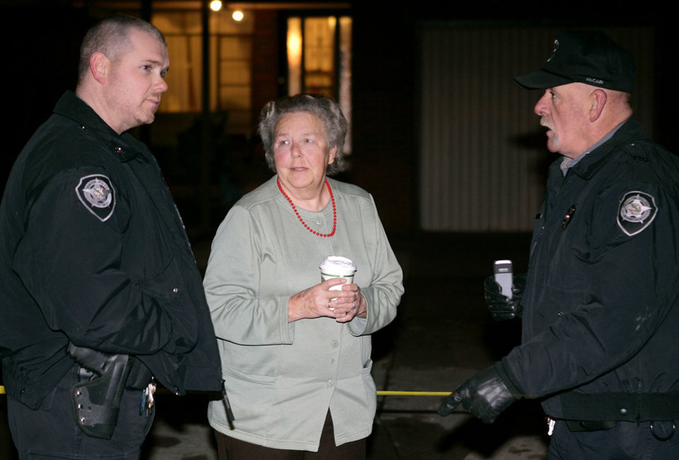 KIDNAP: June Heldermon, 71, center, of Hinton, Okla., is shown with two Hinton, Oklahoma Police Department officers outside a home at 3738 19th Street, in Oklahoma City, where she was found after her kidnapping ordeal Monday night, Jan. 22, 2007, in Oklahoma City. Heldermon says she was kidnapped from her Hinton home by two escaped prisoners from a prison near Hinton, Okla., and was forced to go with the suspects in her car to Oklahoma City, where the suspects then intruded into another woman's home, on 19th St.,  in Oklahoma City and stole her vehicle. Two suspects being sought are Charles McDaniels and Tony L. Ellison. By Bill Waugh, The Oklahoman.